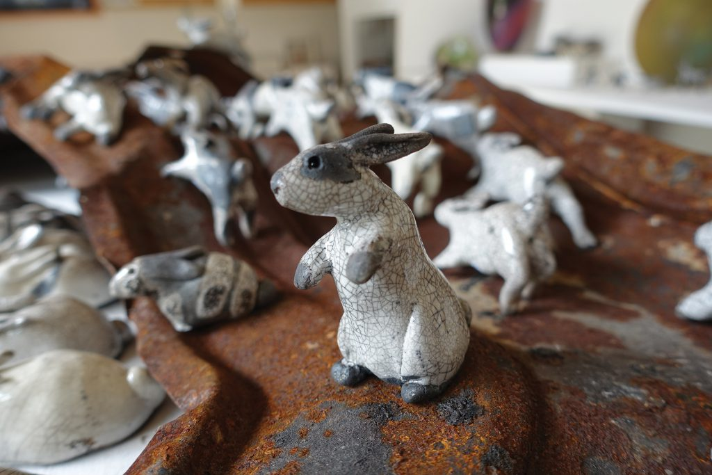 'Gazer' the raku rabbit with a herd of bouncing bunnies