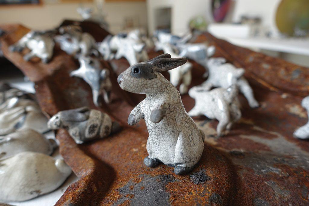'Gazer' the raku rabbit with a herd of bouncing bunnies