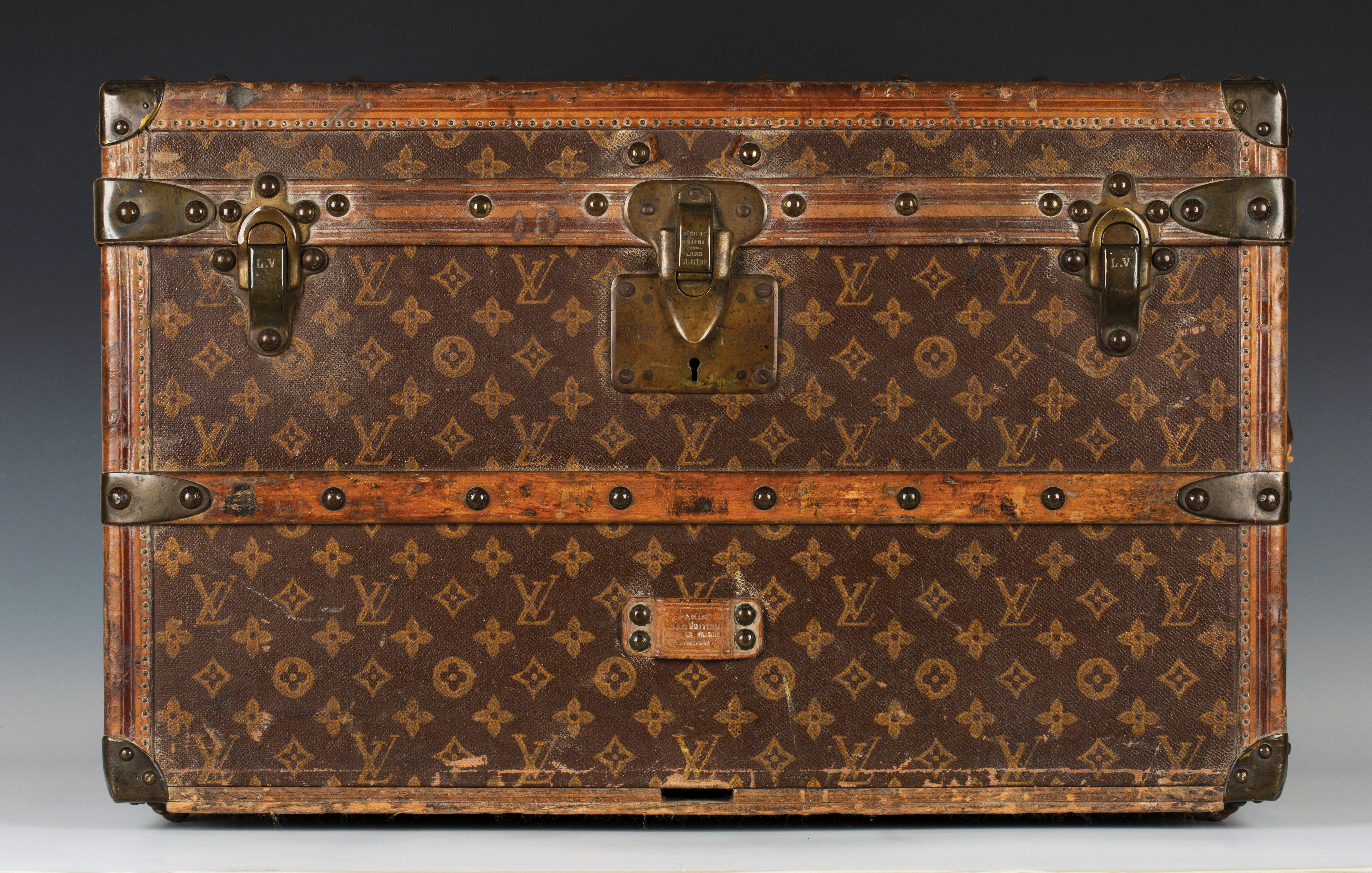 e35839f62535 A Louis Vuitton travelling trunk with overall LV monogram decoration on a  brown ground and a