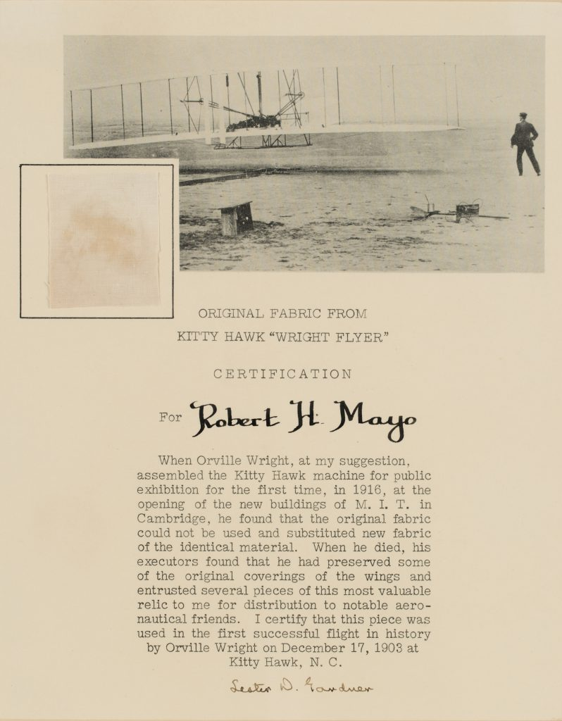 A small section of original fabric from the Wright brothers Kitty Hawk 'Wright Flyer' with a printed certification from Major Robert H. Mayo