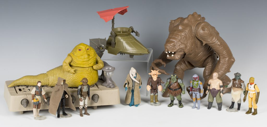 Jabba the Hutt, the Rancor, Luke Skywalker, Boba Fett and Lando Calrissian with other characters from The Return of the Jedi