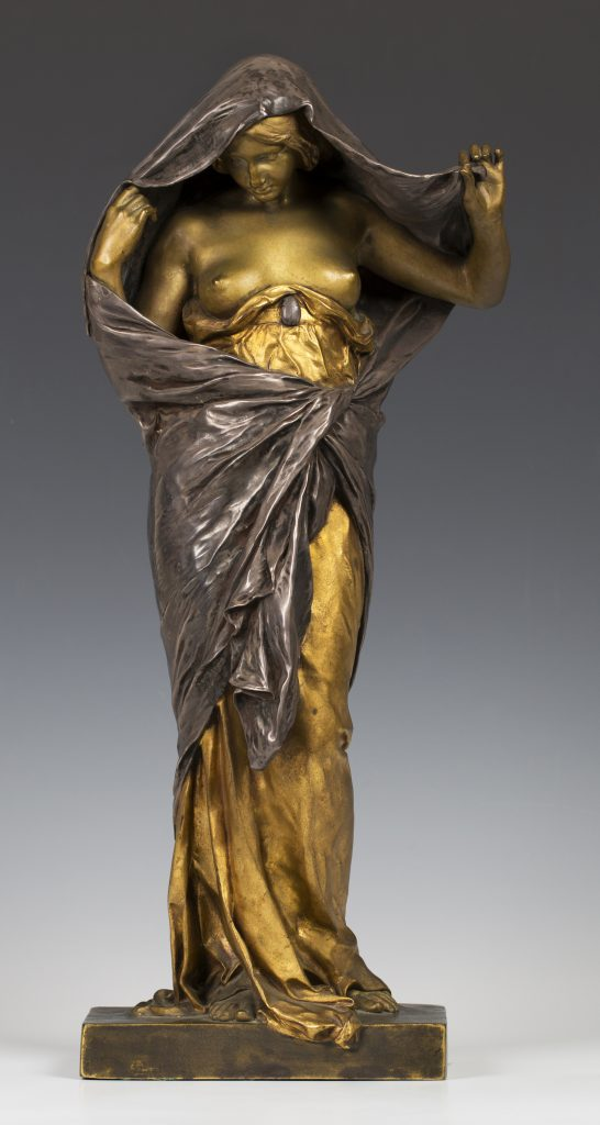 Louis-Ernest Barrias - Nature unveiling Herself before Science, a late 19th/early 20th century gilded and silvered cast bronze figure of a standing maiden