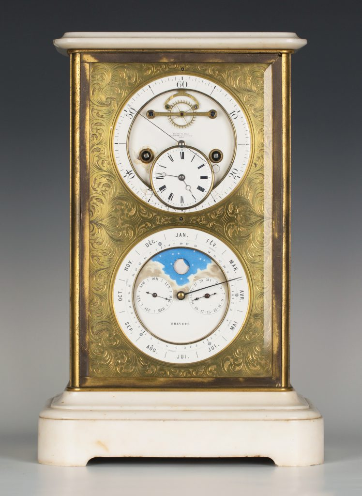 A late 19th century French lacquered brass and white marble four glass table clock with perpetual calendar and moonphase by Le Roy & Fils of Paris