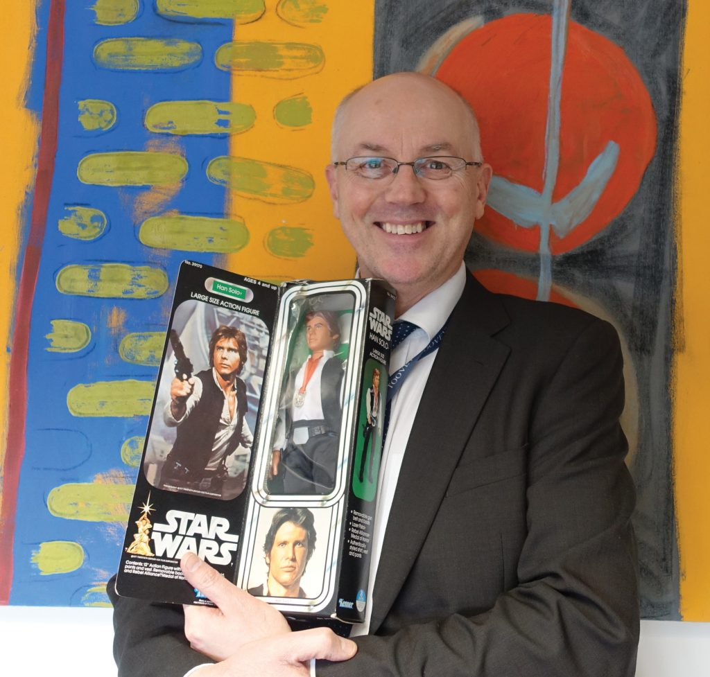 Toovey's toy specialist Chris Gale with a rare Star Wars Han Solo Action figure