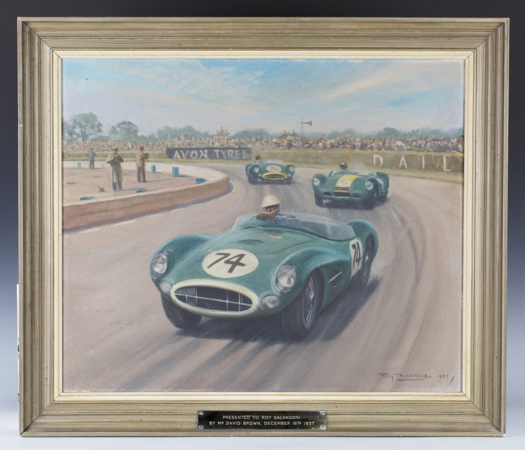 An oil painting by Roy Nockolds of an Aston Martin DBR1/300 with a presentation plaque to Roy Salvadori from Aston Martin owner David Brown