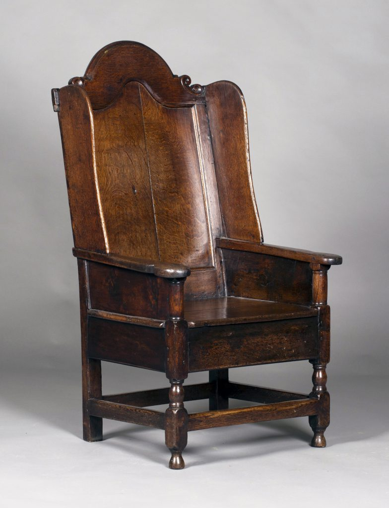 A late 17th/early 18th century Wainscot chair with rare wing back and box seat