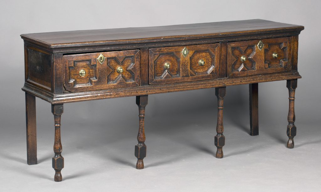 A late 17th Century oak dresser base with geometric moulded decoration