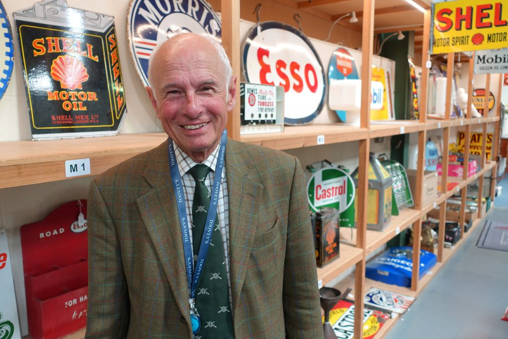 Automobilia specialist Gordon Gardiner with an array of motoring collectables at Toovey's