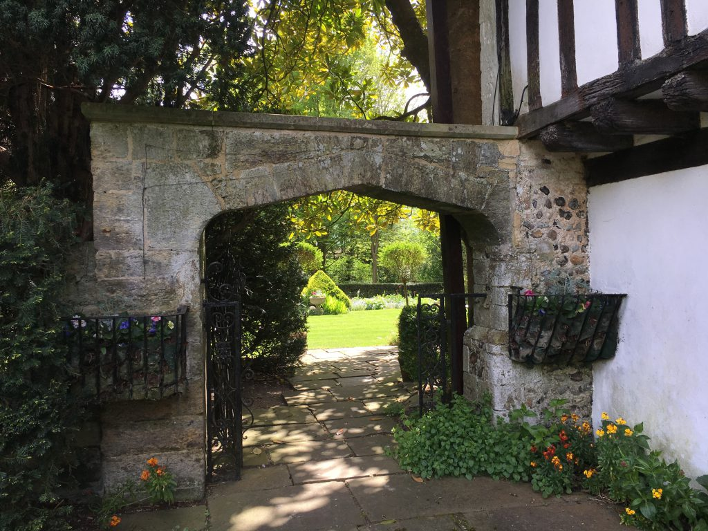 An ancient arch opening onto one of St Mary's beautiful gardens