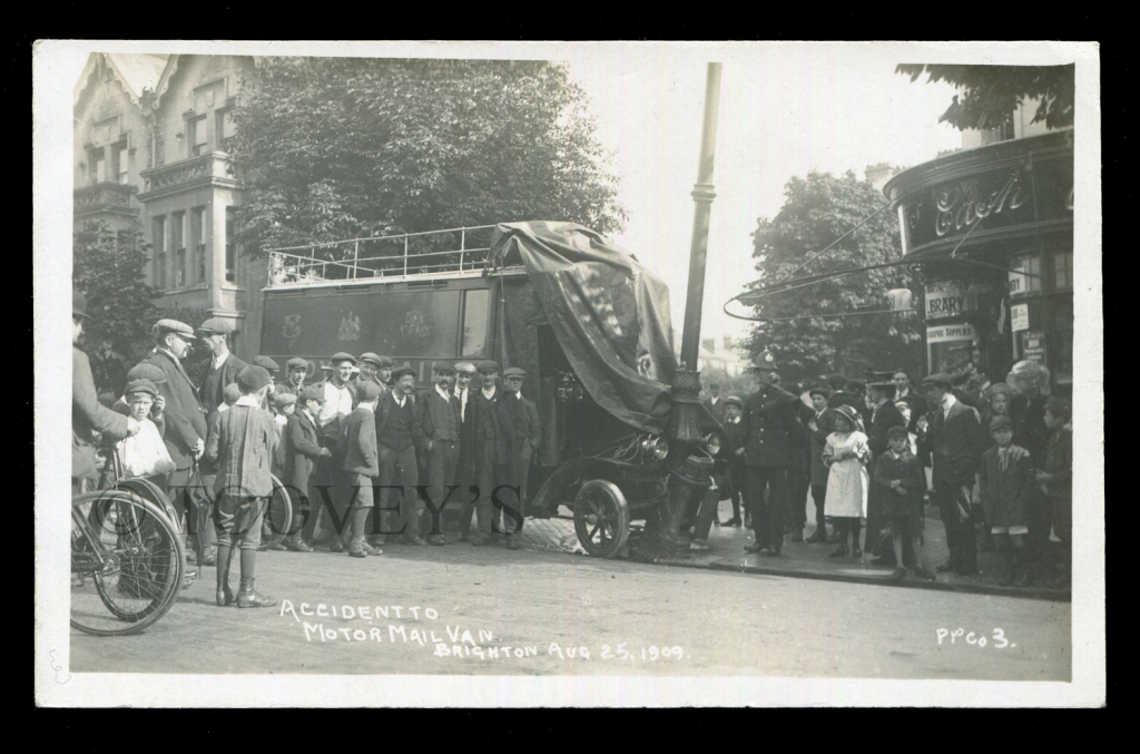 A Sussex postcard titled 'Accident to Motor Mail Van, Brighton, Aug 25, 1909'